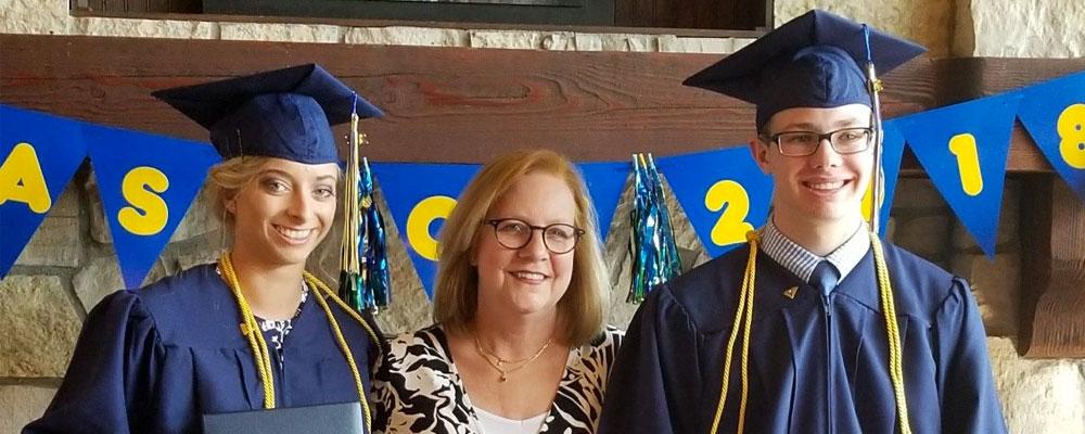 Whitmore School graduates with principal