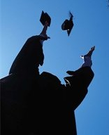 silhouette of a graduate tossing cap in air