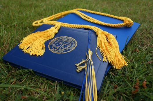 diploma with honors cords and tassle