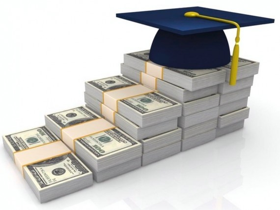 stack of money with graduation cap on top