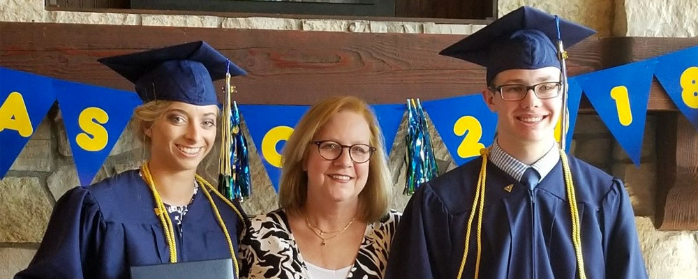 Whitmore School graduates with principal