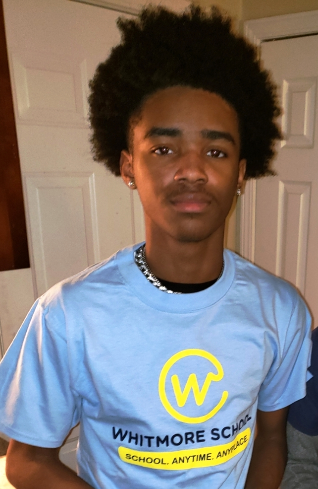 Myles T. wearing his Whitmore School t-shirt