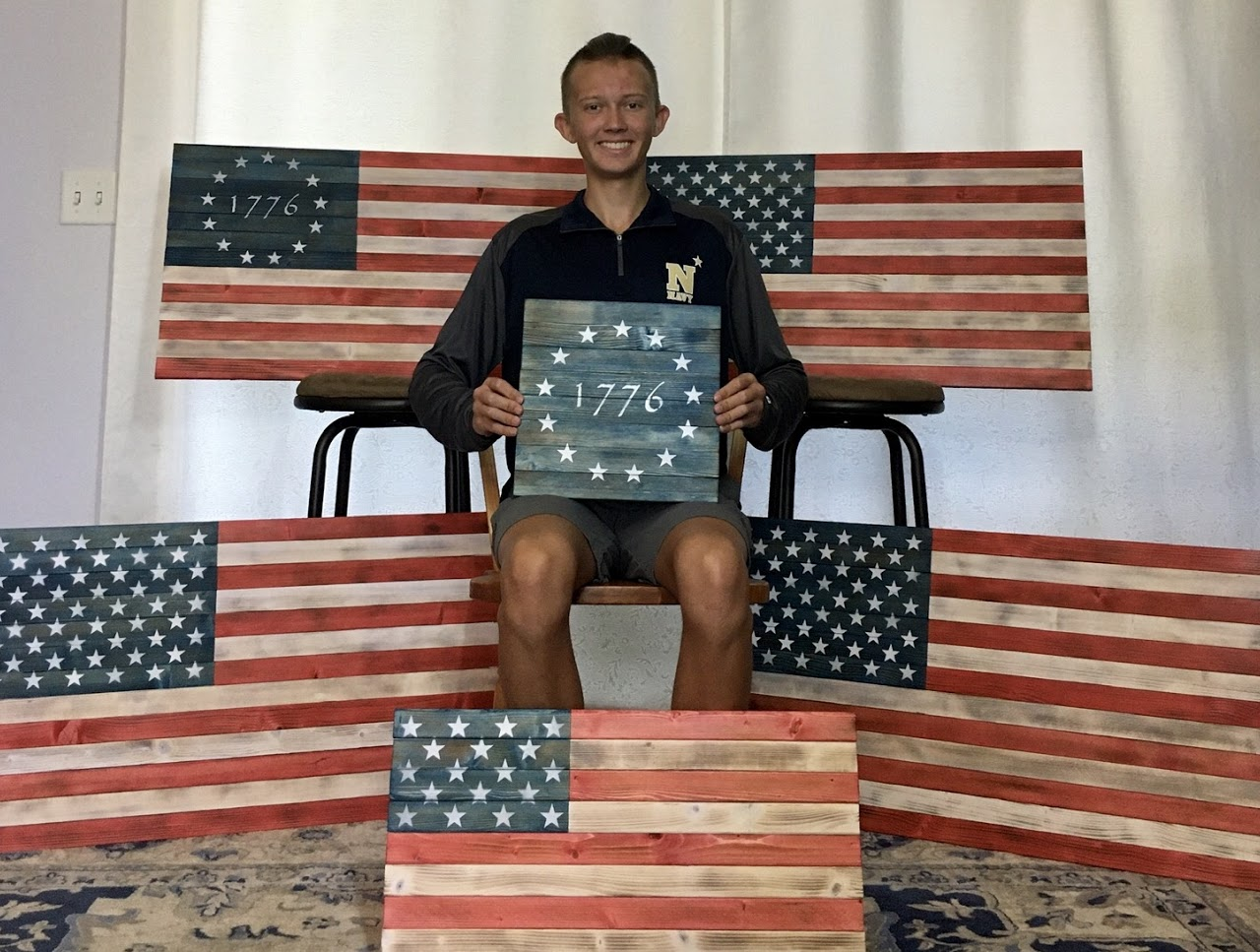 Ryan C. holding custom made wooden flag
